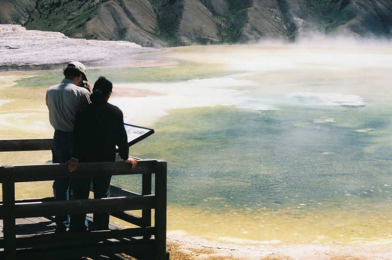 A couple enjoying Yellowstone Prismatic Spring