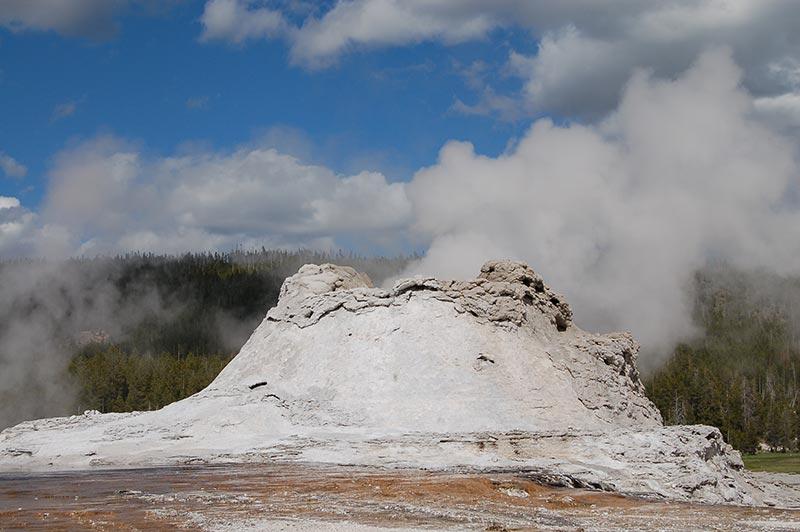 Yellowstone beautiful geyser while touring yellowstone