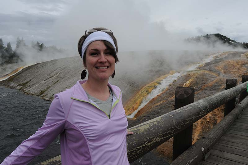 A girl smiling during the tour of Yellowstone