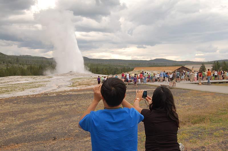 Yellowstone people doing geyser photography