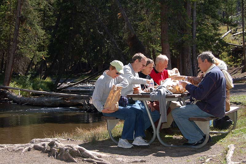 Tourists doing lunch while touring Yellowstone